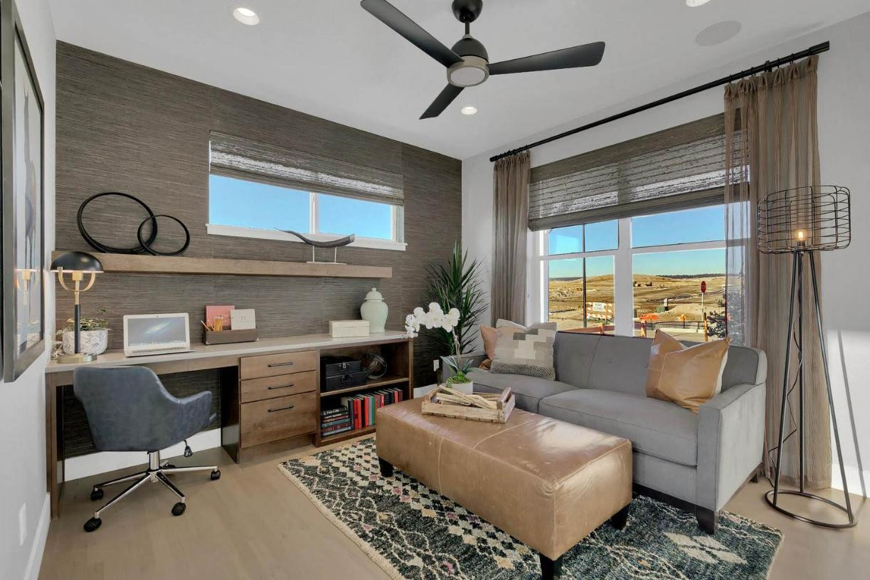 Flex room located off the foyer creates the ideal home office space