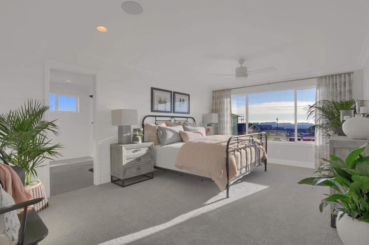 The primary bedroom suite affords space for larger furniture and a cozy sitting area