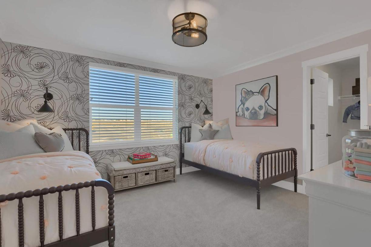 One of the secondary bedrooms with a walk-in closet