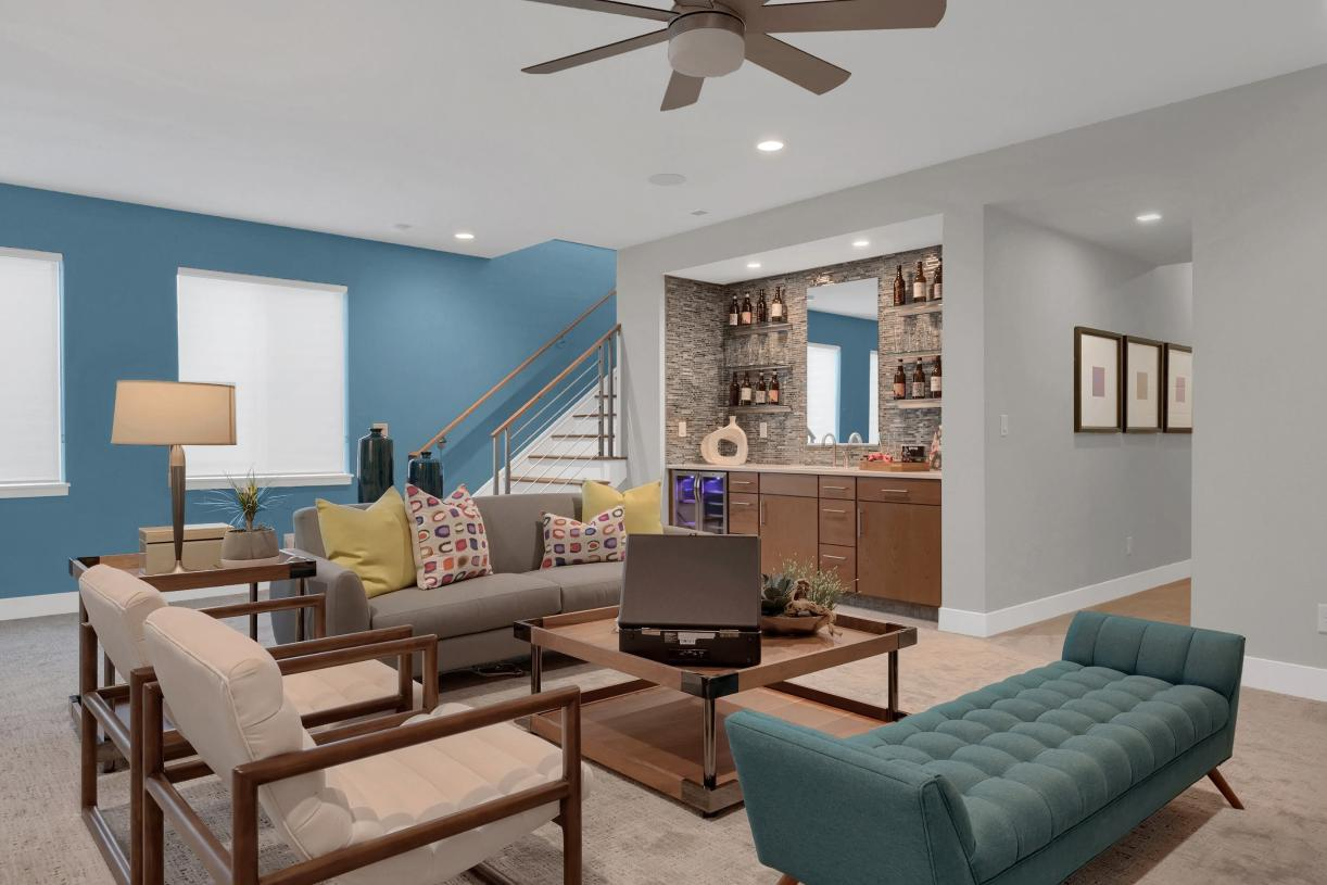 Add a wet bar and furniture to the basement flex space to create a retreat at home