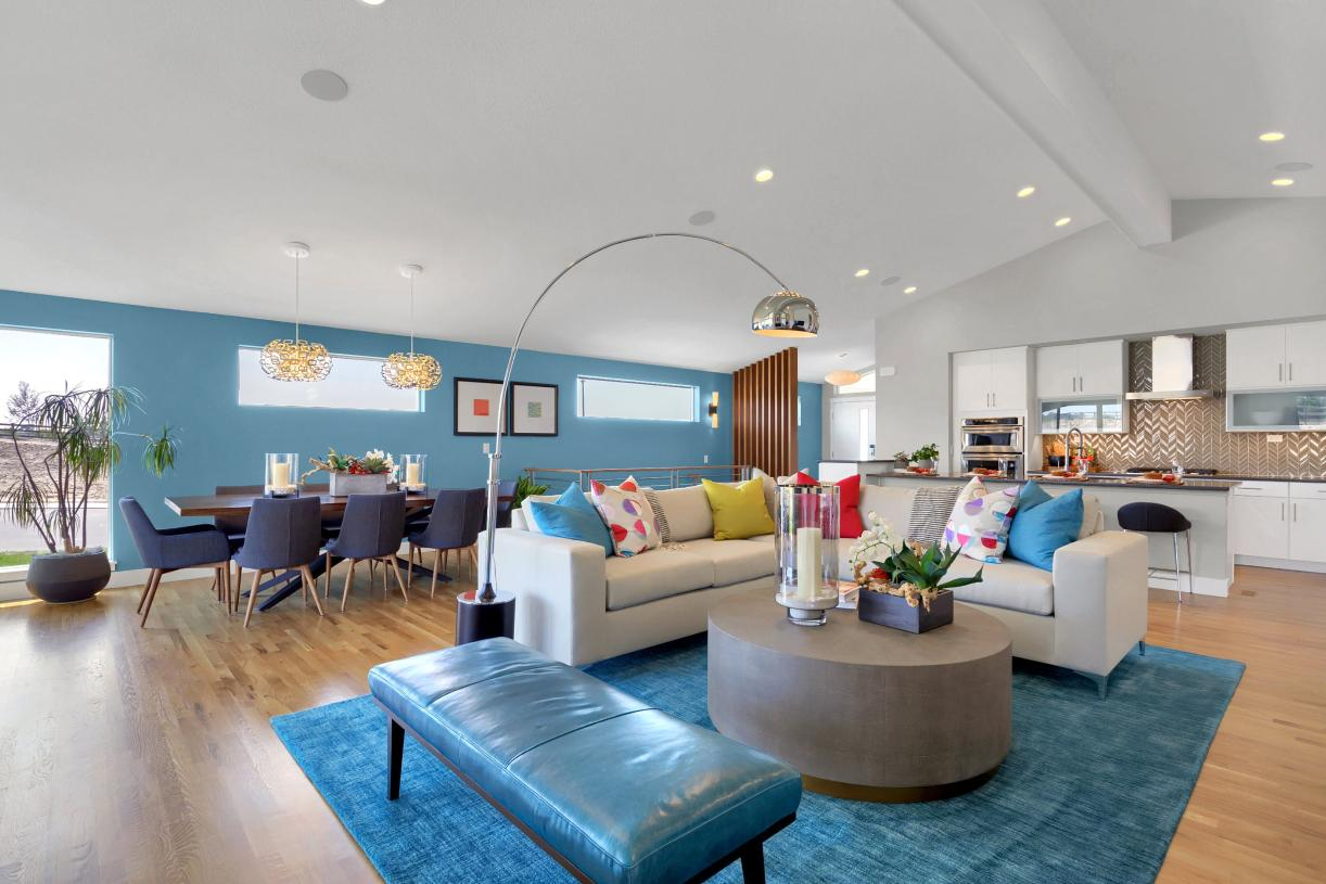 The connected main level is perfect for entertaining, tied together by the vaulted ceilings