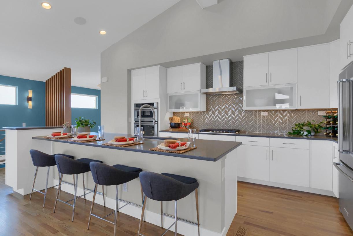 Expansive kitchen featuring a large island, providing additional seating
