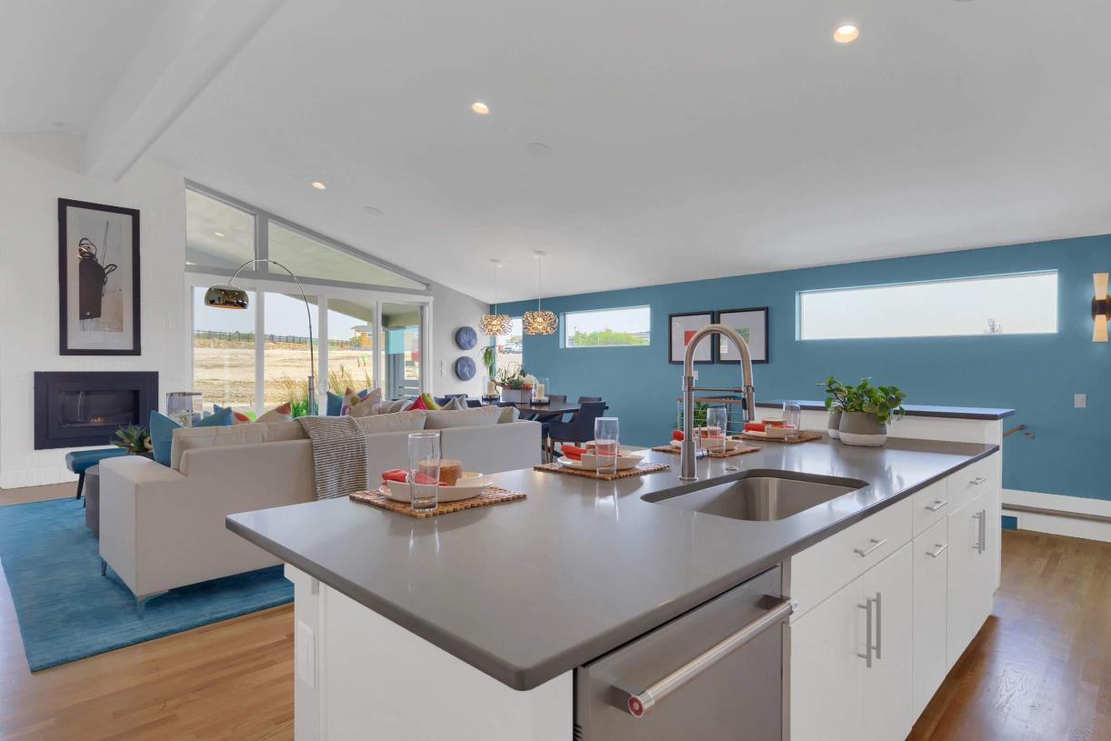 The kitchen overlooks the great room and casual dining for an open feel