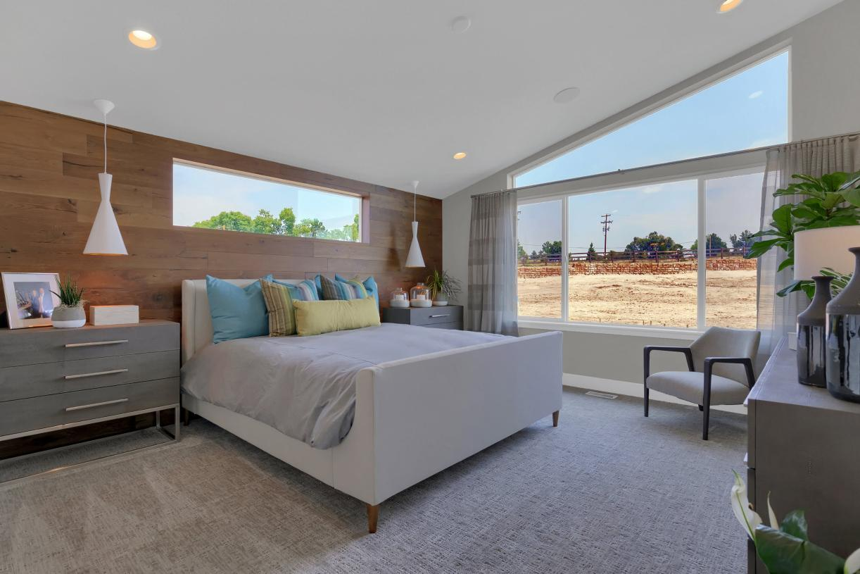 Relax from a long day in the private primary bedroom suite