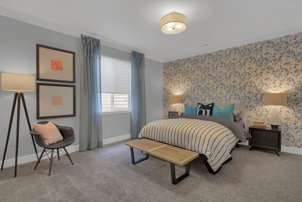 The basement bedroom can function as an additional guest bedroom or as a private living quarter