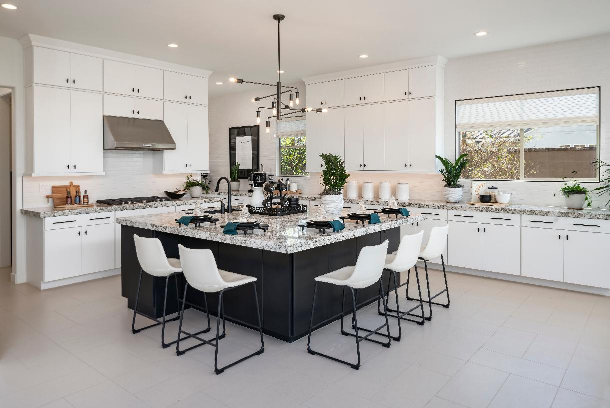 Kitchen with stainless steel appliances, white cabinets and granite countertops