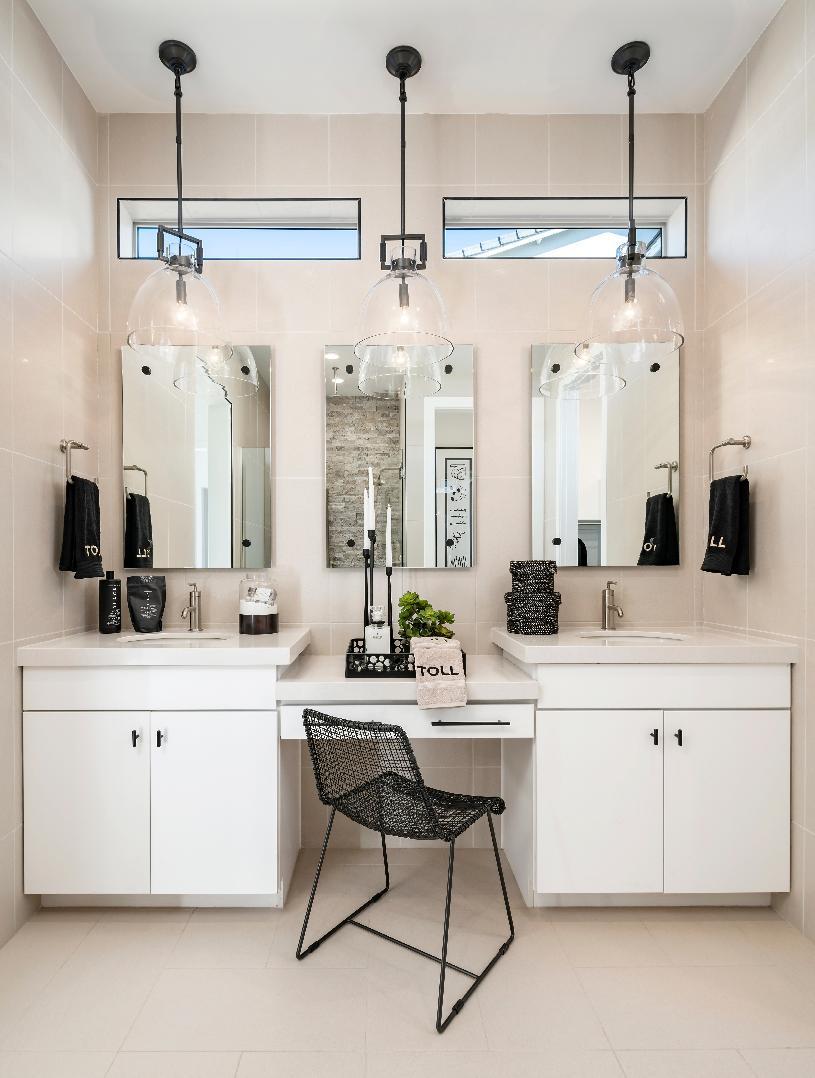 Primary bathroom with dual-sink vanity and knee space