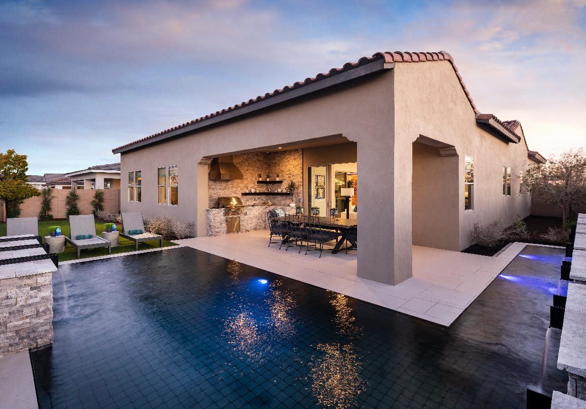 Large covered patio and luxurious pool for optimal outdoor living