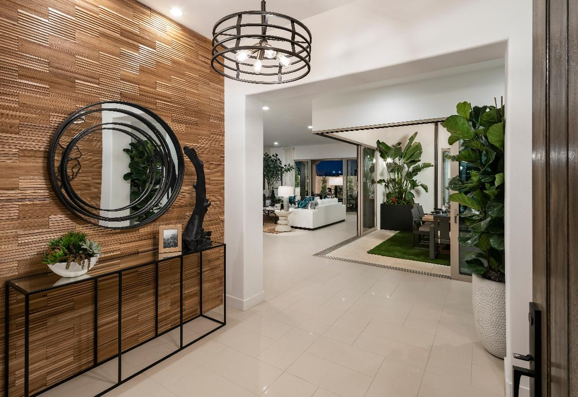 Welcoming foyer with eye-catching accent wall