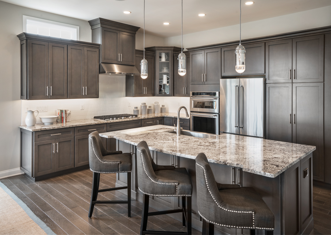 Well-appointed kitchen with large center island and abundance of cabinet space