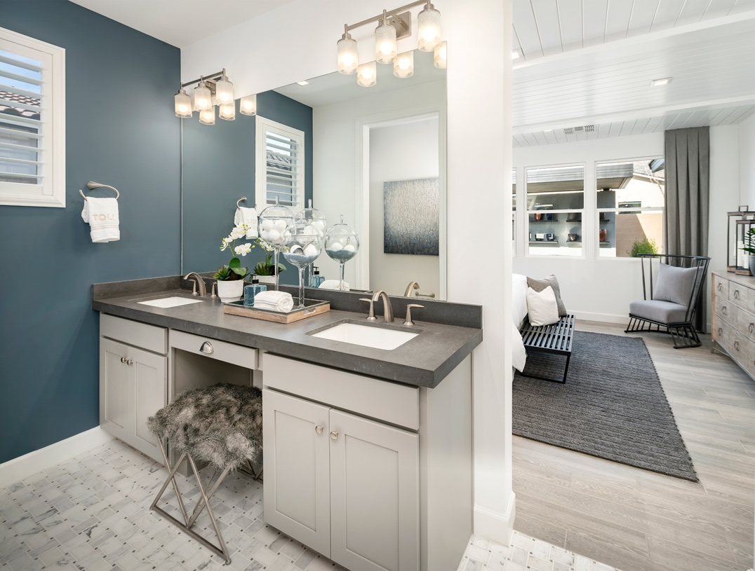 Primary bathroom with a dual-sink vanity and knee space