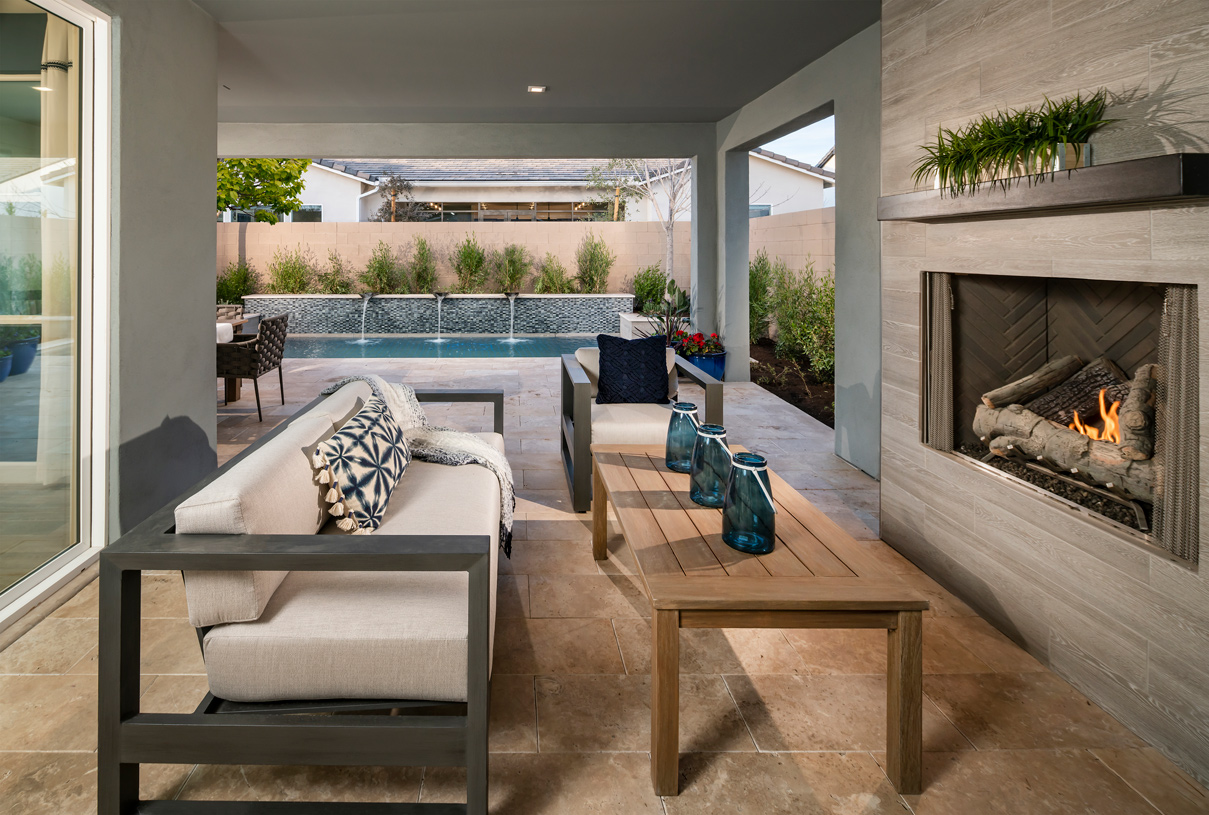 Covered patio with an elegant fireplace