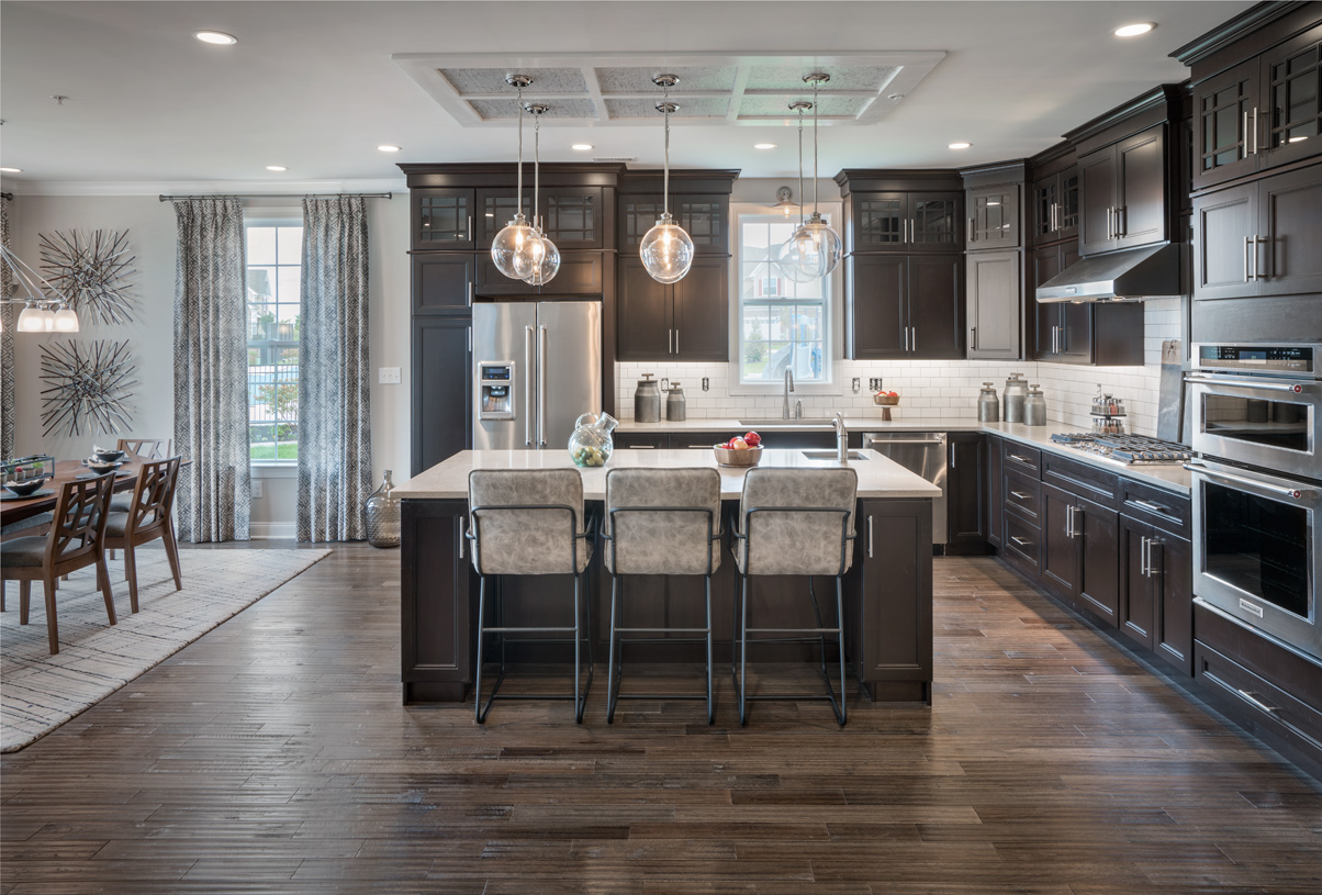 Well-appointed kitchen with large center island and stainless steel appliances