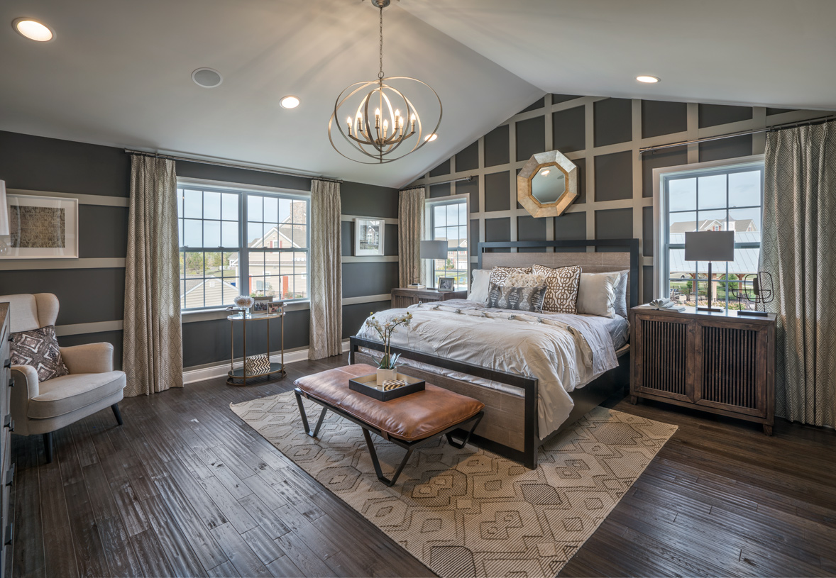 Primary bedroom suite with cathedral ceiling