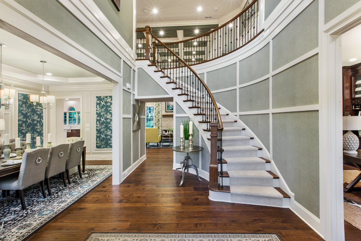 Impressive foyer with turned stair and formal dining room entry