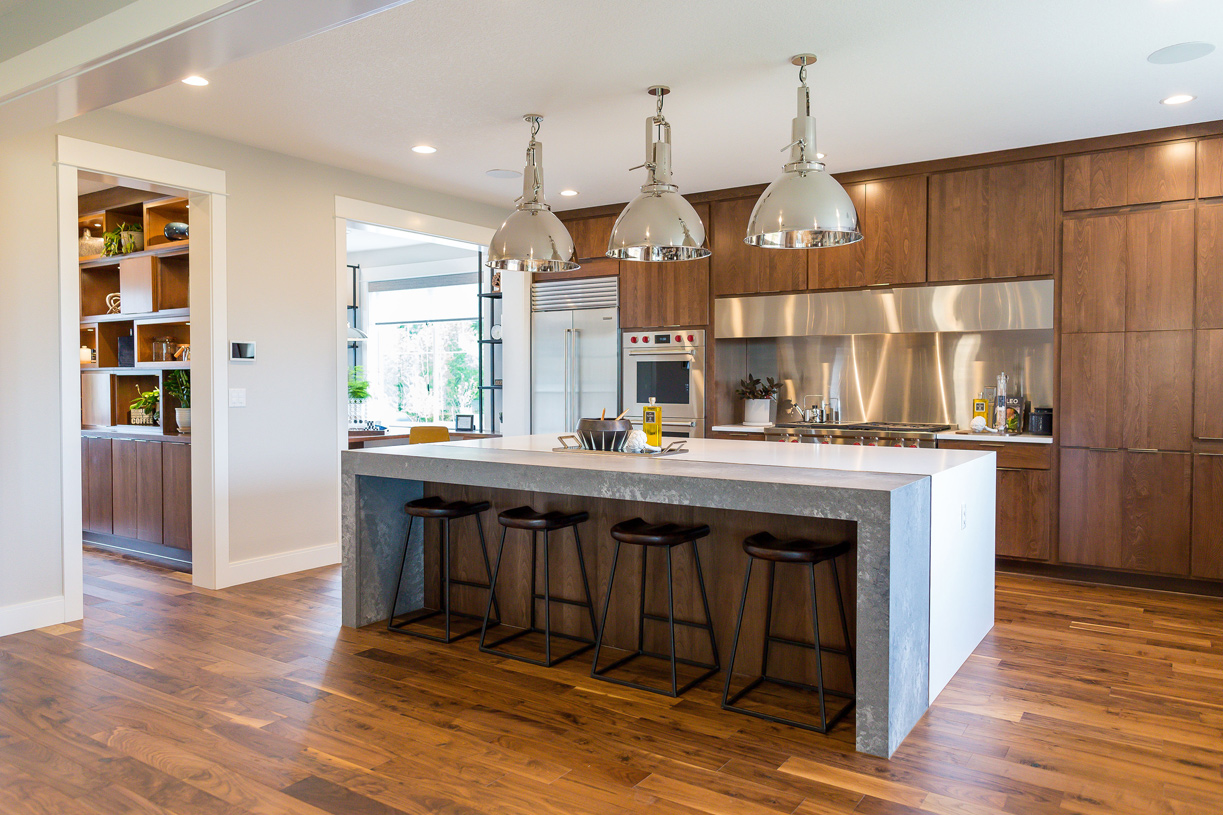 Gourmet kitchen with countertop seating at the island
