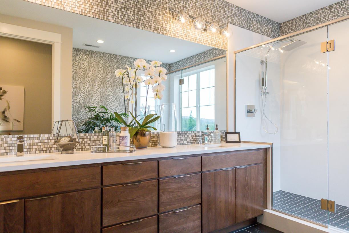 Luxe primary bath with dual vanities
