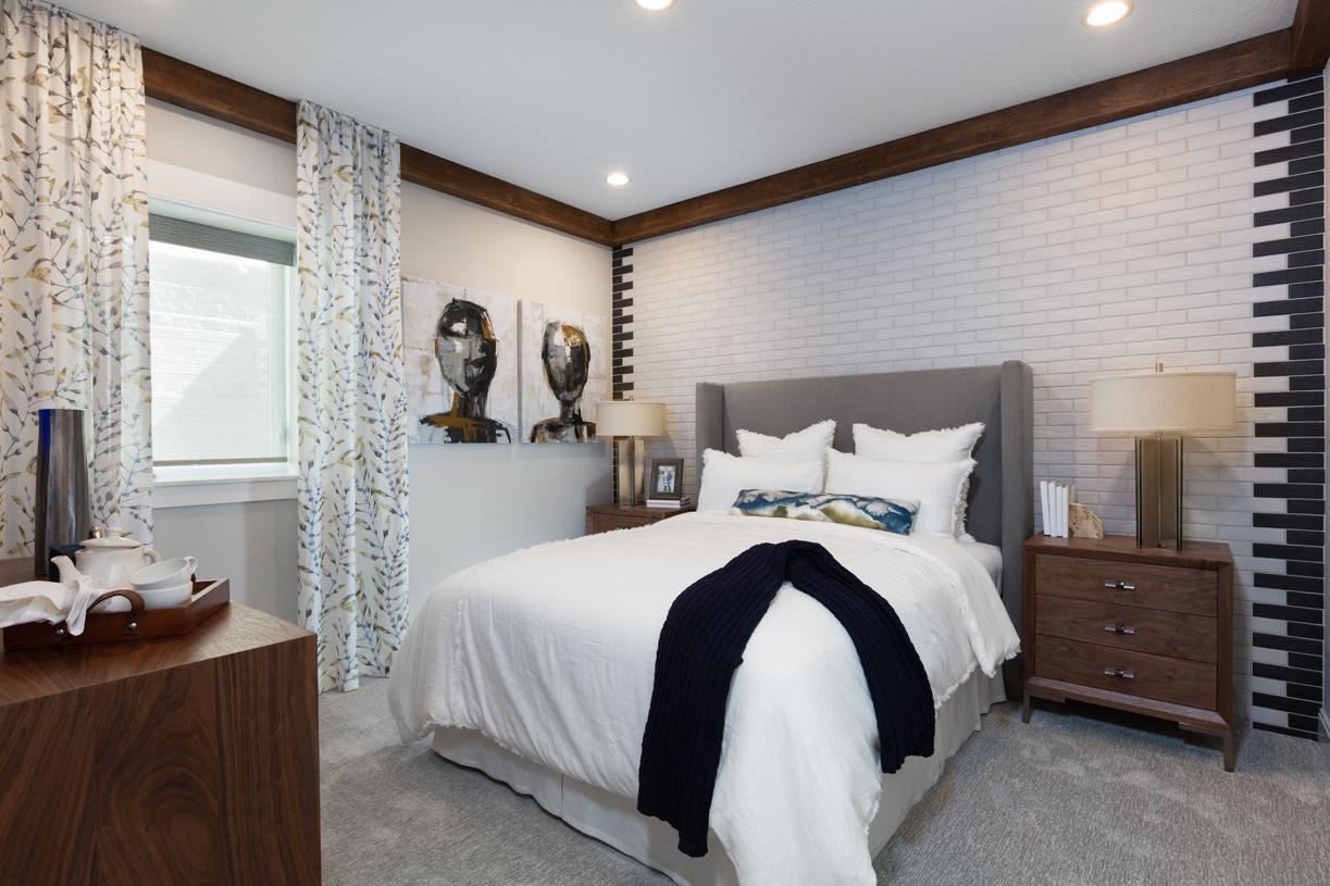 Main floor bedroom provides a cozy retreat for guests
