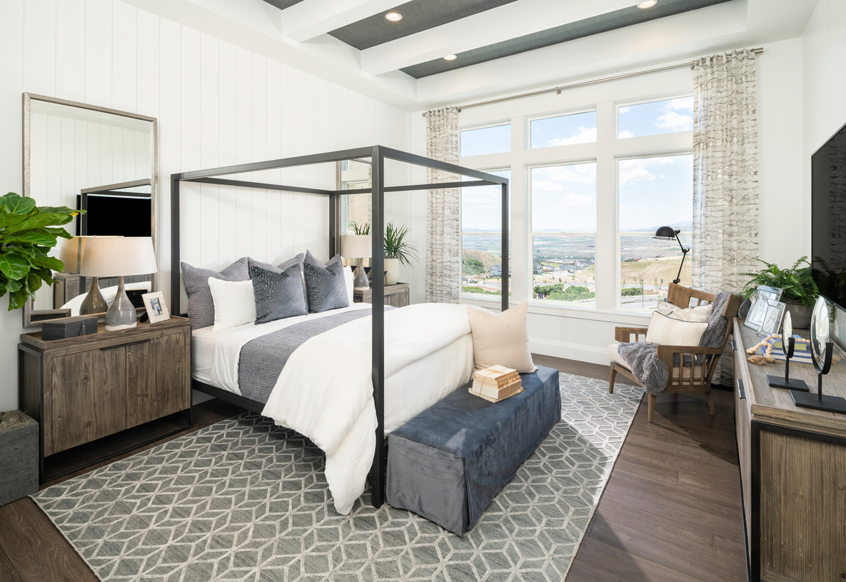 Luxurious primary bedroom suites with seating spaces