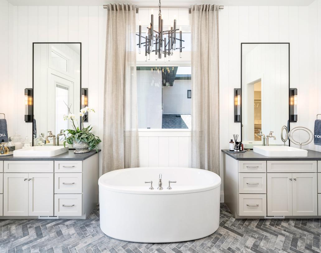 Lavish primary bathrooms with dual split vanity and large soaking tub