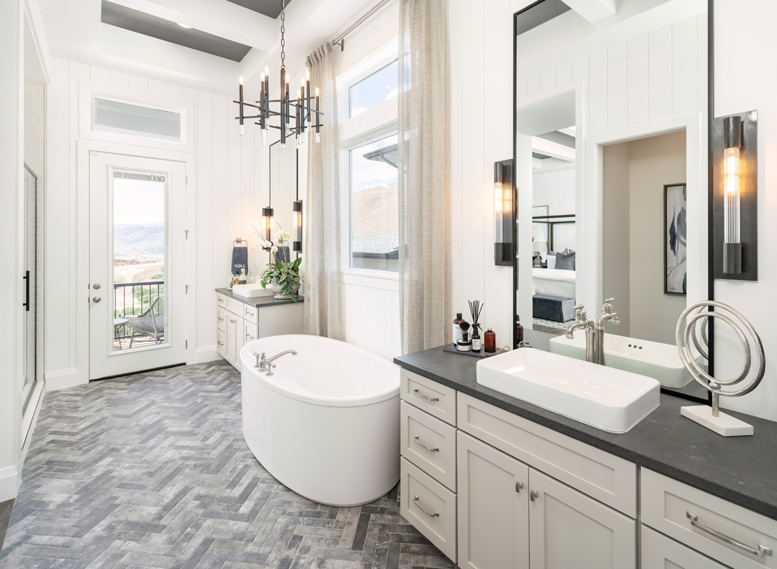 Luxurious primary bathroom with access to side patio