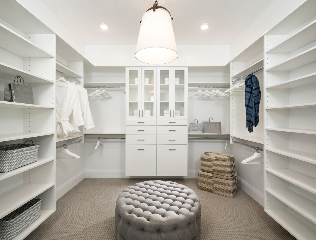 Huge primary walk-in closet with ample storage
