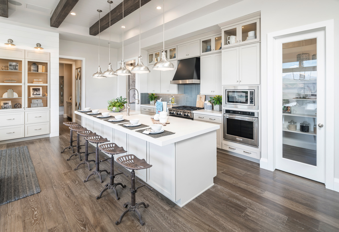 Large center islands with a breakfast bar for casual dining