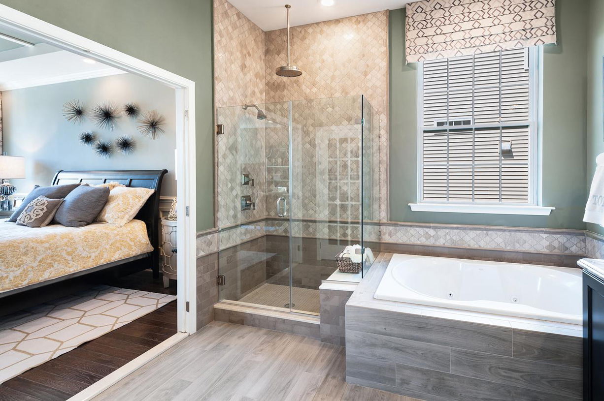 Primary bathroom with glass enclosed shower