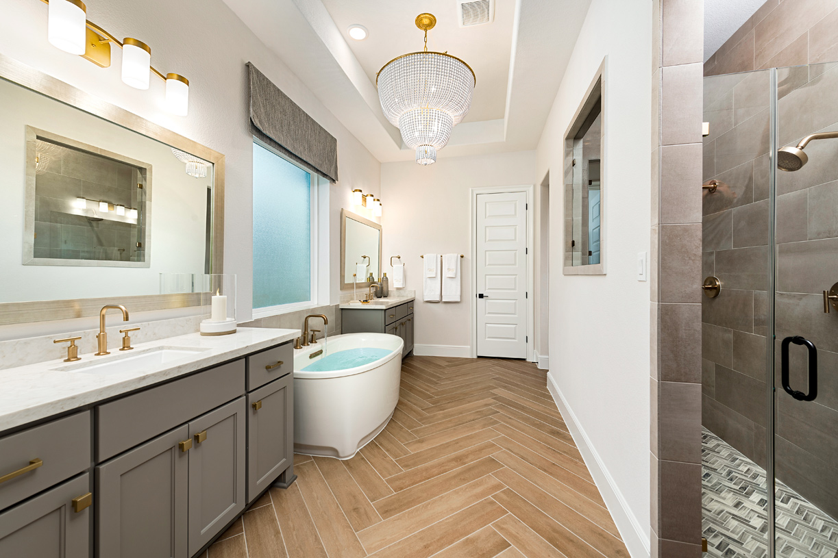 Relax in a spa-like primary bathroom with dual vanities