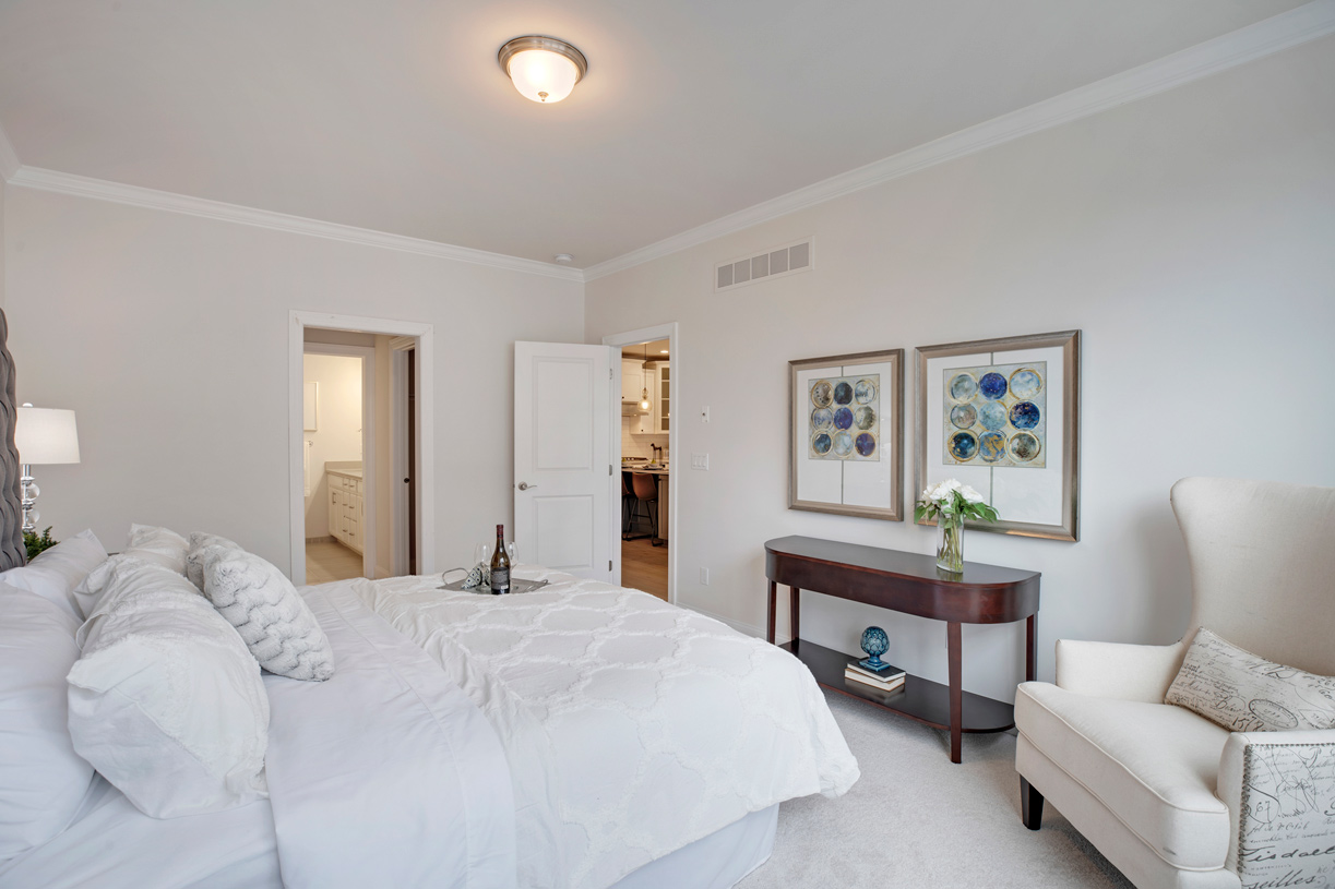 First-floor primary bedroom suite with large walk-in closet
