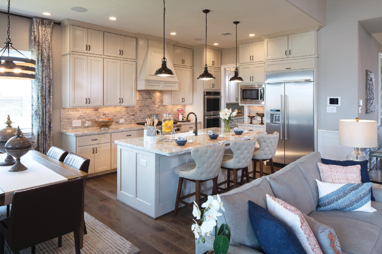 Well-appointed kitchen with large center island and huge walk-in pantry