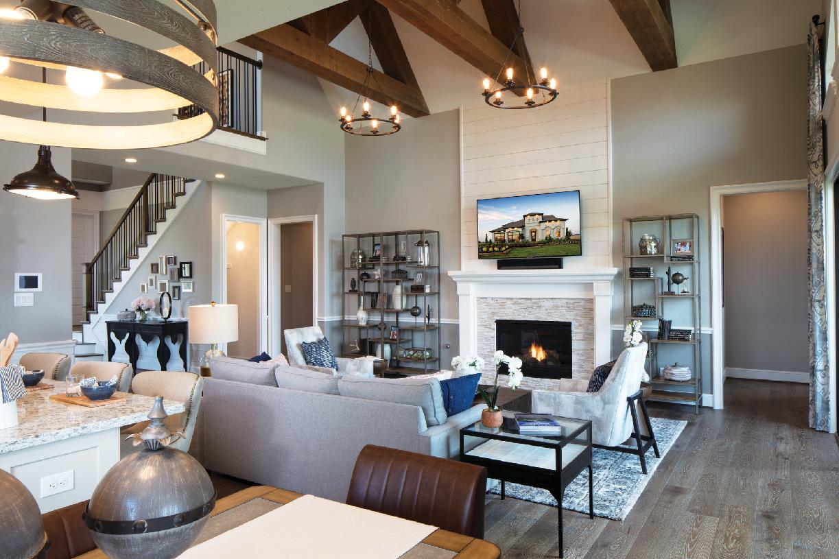 Inviting great room features a vaulted ceiling and a fireplace