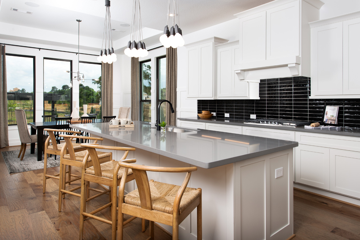 Well-designed kitchen is equipped with a large center island