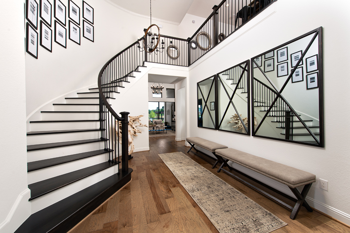 Two-story foyer with elegant curved staircase