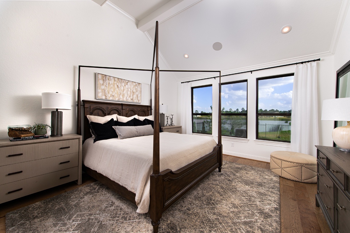 Primary bedroom suite is enhanced by a cathedral ceiling