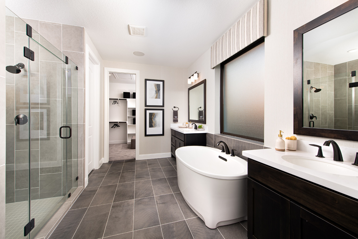 Resort-style primary bath with walk-in closet