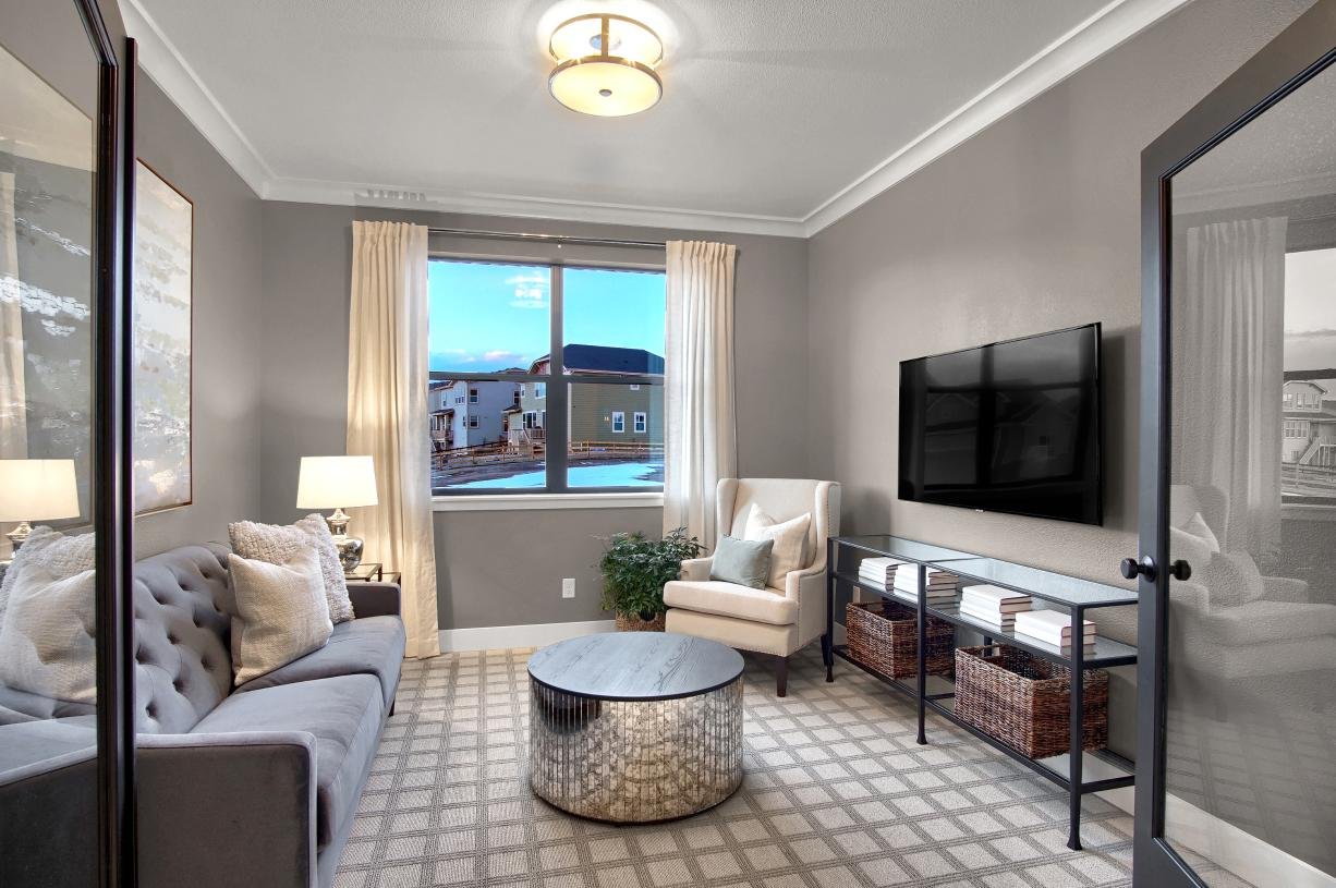 The main level flex room is the perfect home office or study space