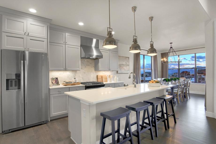 Kitchen featuring a large, centered island, adjoining the casual dining area for easy entertaining