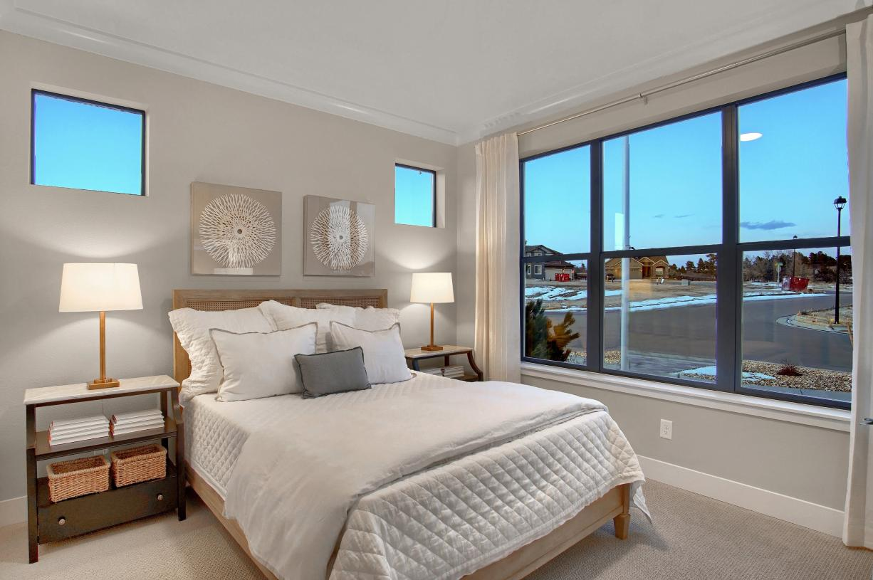 Cozy main level secondary bedroom is convenient for guests