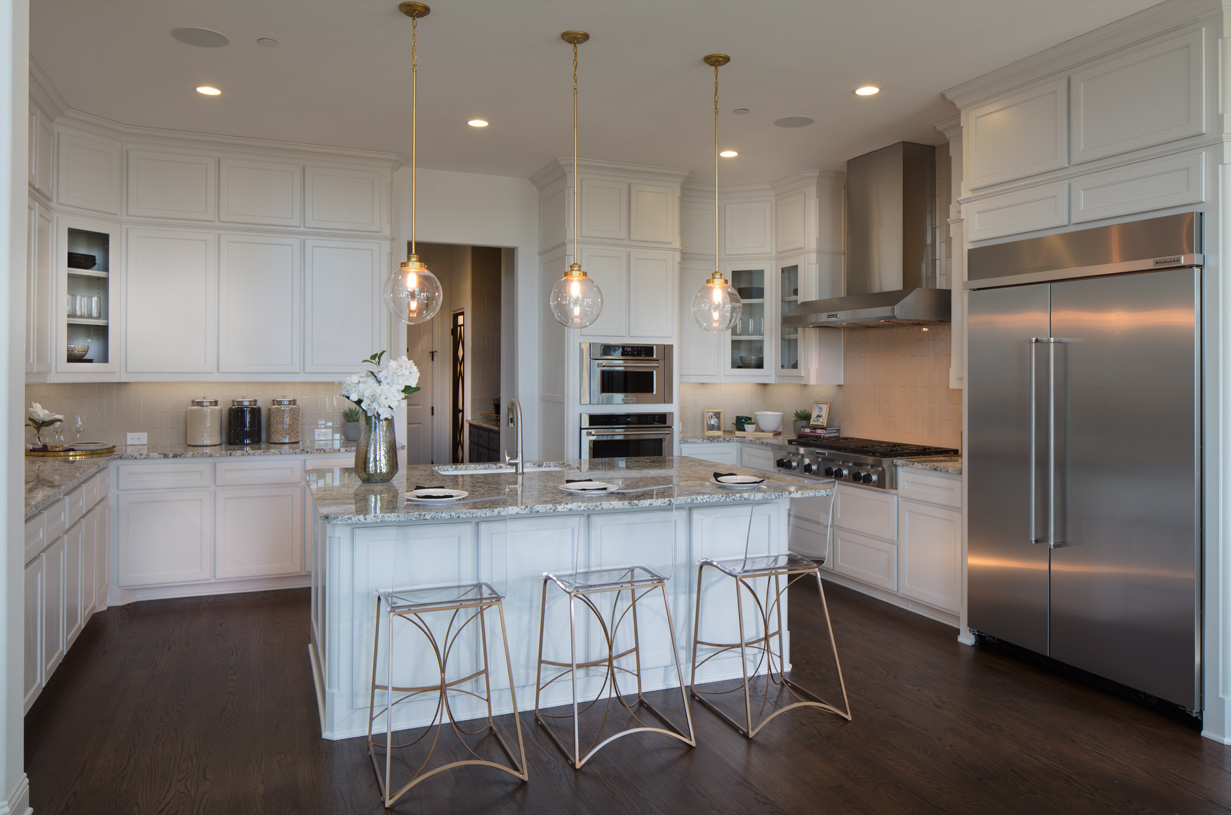 Desirable open kitchen with breakfast bar and ample counter space