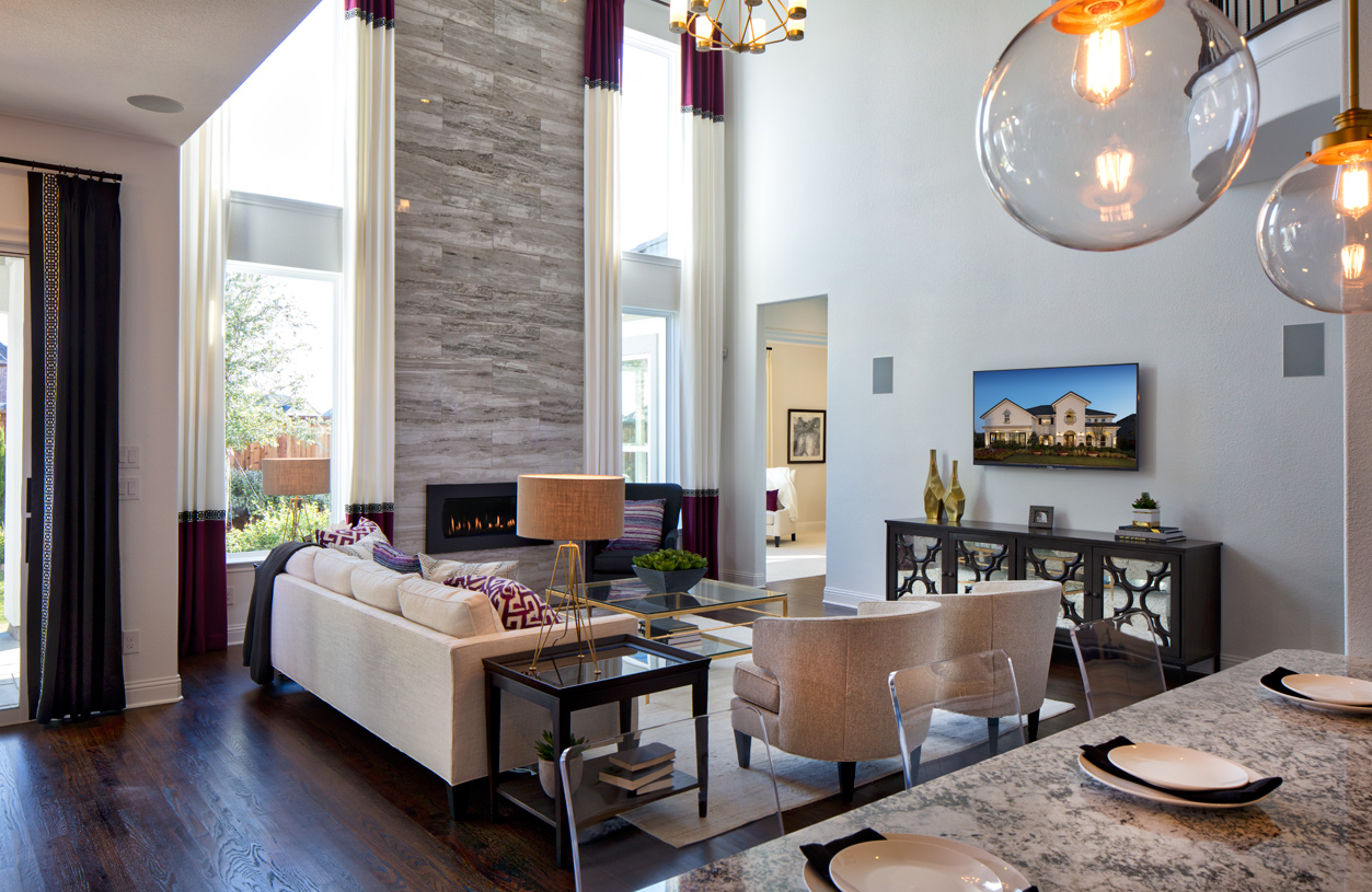 Two-story great room includes a fireplace