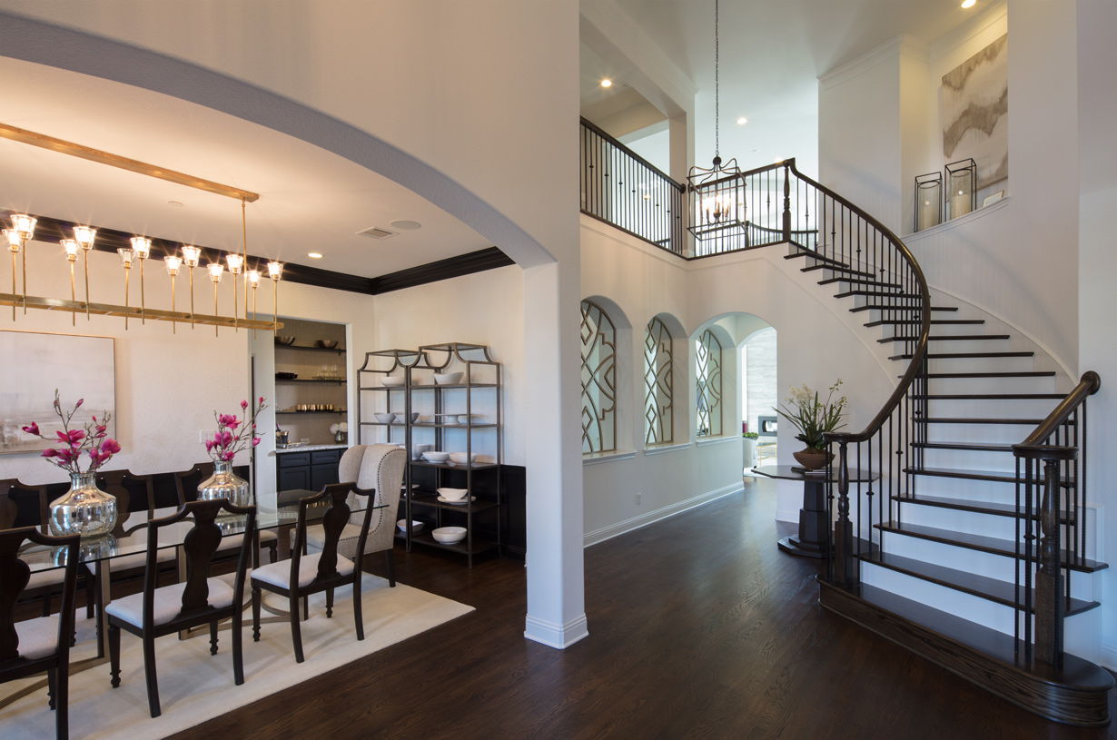 Dramatic two-story foyer with elegant curved staircase