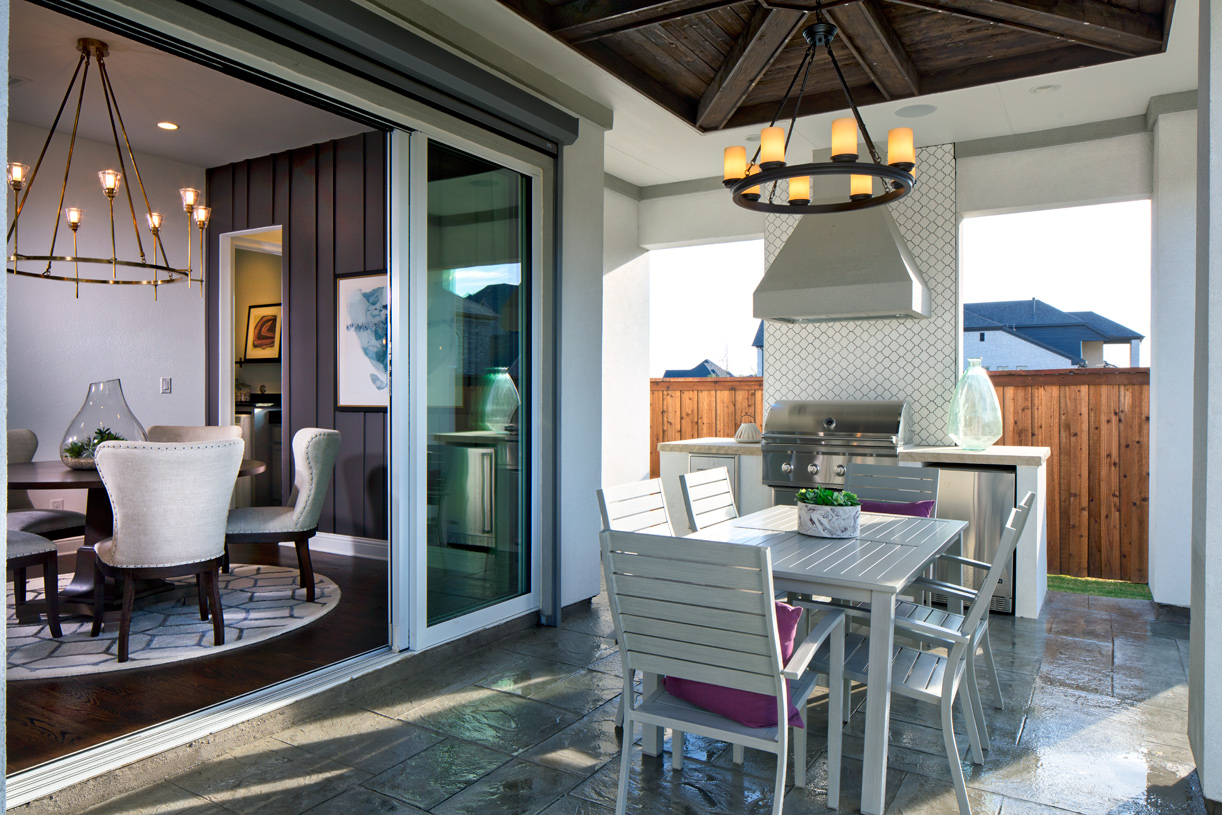 Covered porch provides extra room for entertaining
