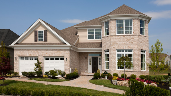 Image of the Merrimack home design with full brick finish located in the Regency at Monroe Community