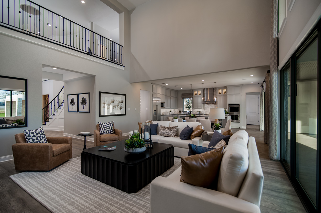Generously proportioned great room is enhanced by natural lighting