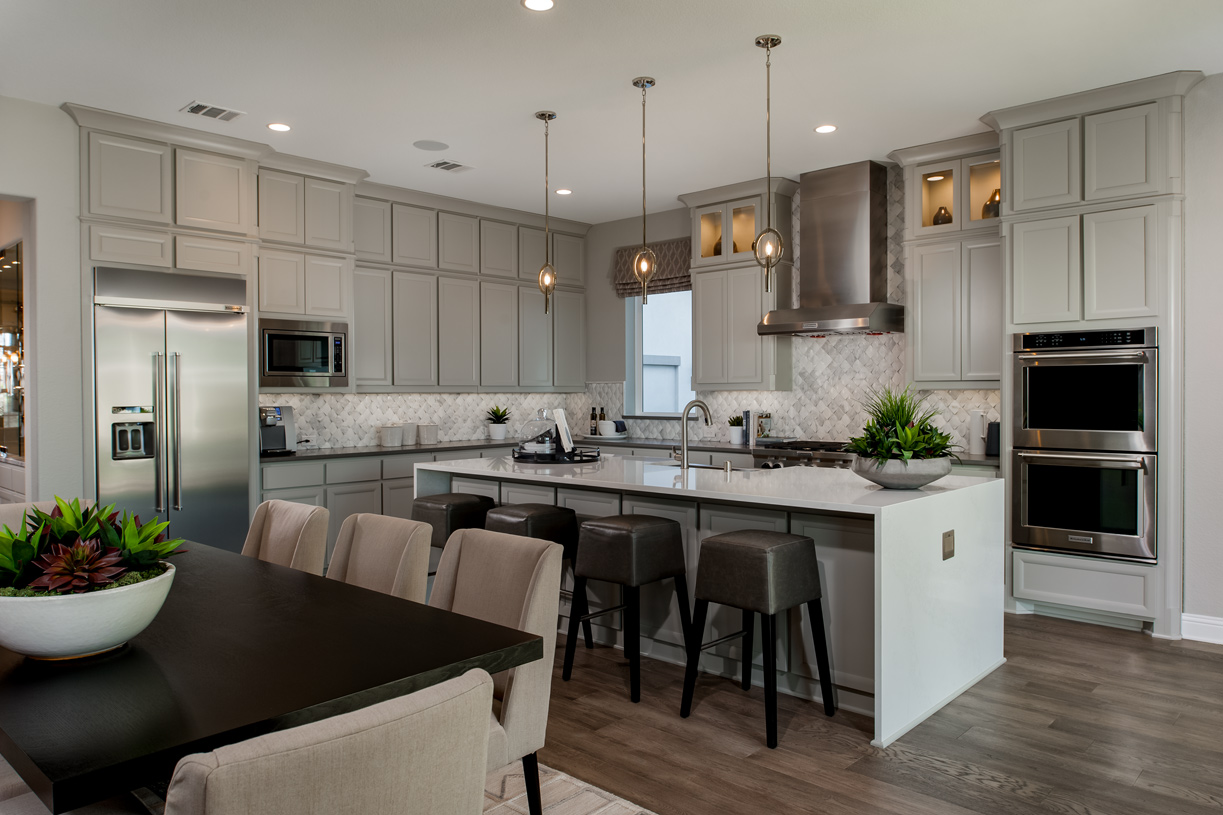 Well-equipped kitchen features a stunning center island and breakfast bar