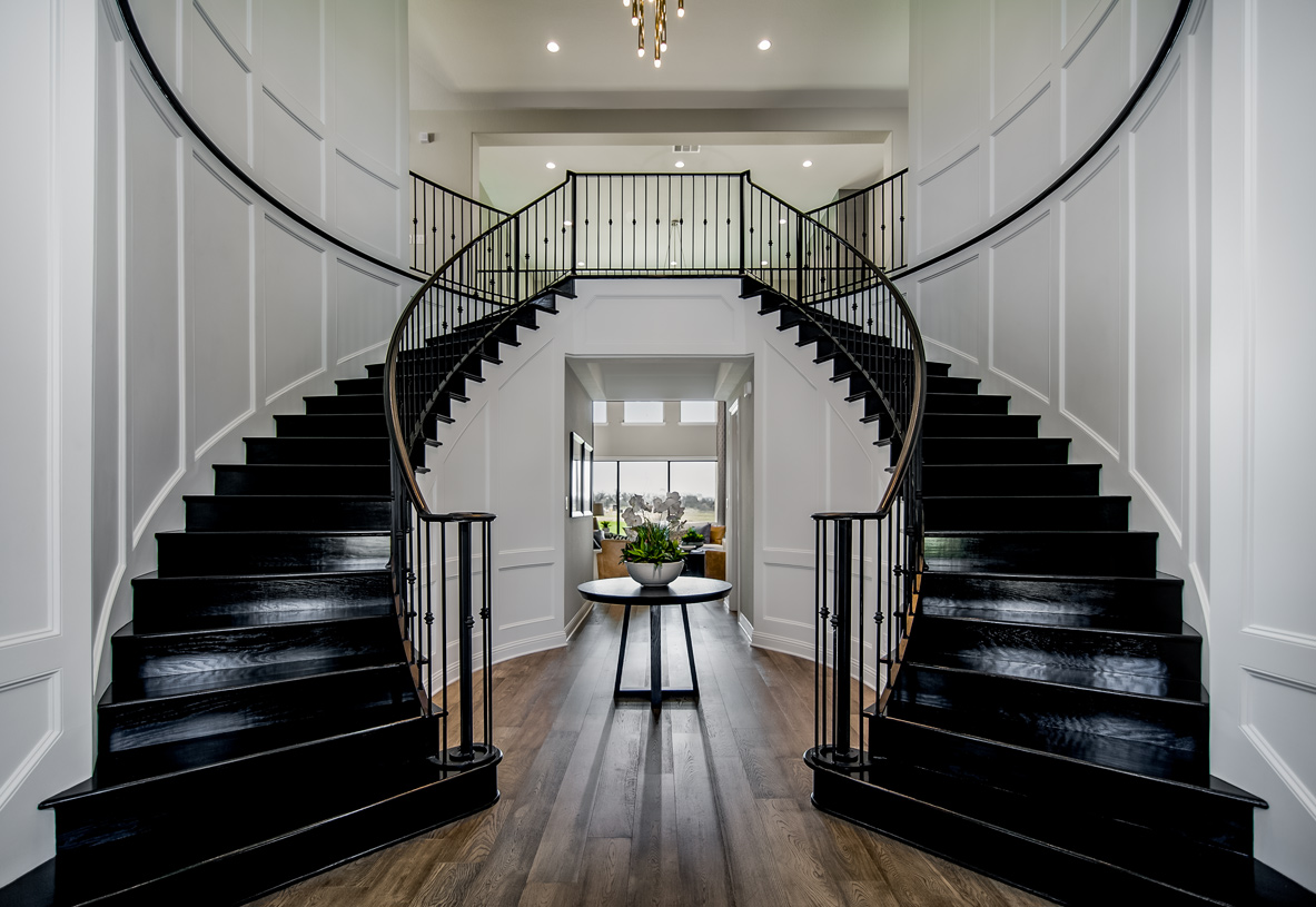 Welcoming two-story foyer and an impressive dual staircase