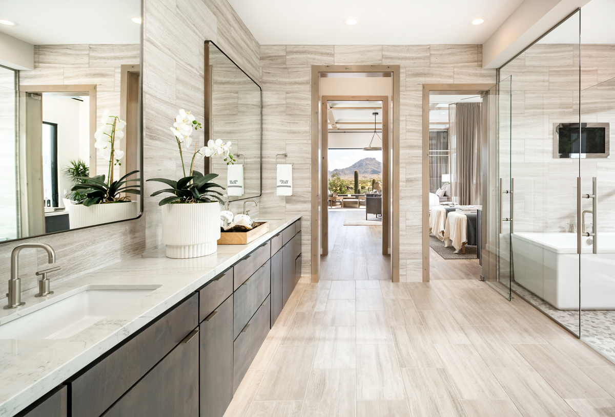 Spa-like primary bath with dual-sink vanity, soaking tub, and oversized walk-in shower