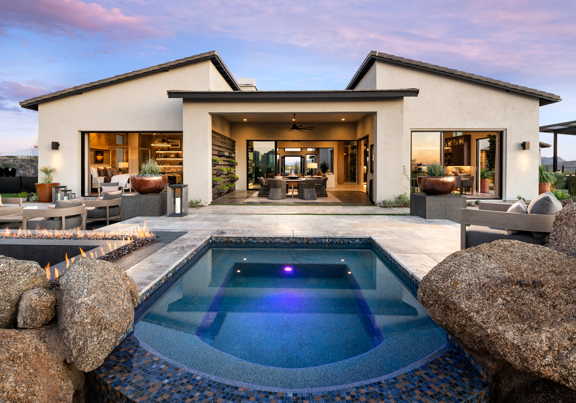 Luxury outdoor living space with spa, gathering areas, and fire feature