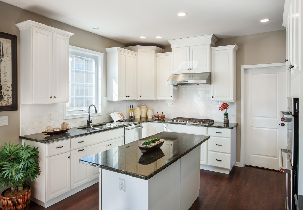 Gourmet kitchen includes Whirlpool® stainless steel appliances, granite countertops, hardwood flooring, and more